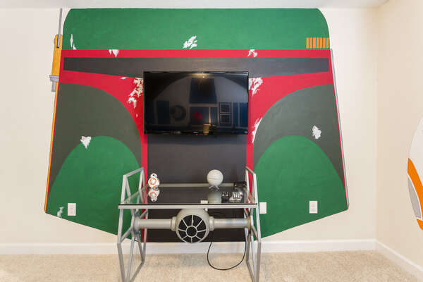 The kids will love the custom artwork in their bedroom and their own TV