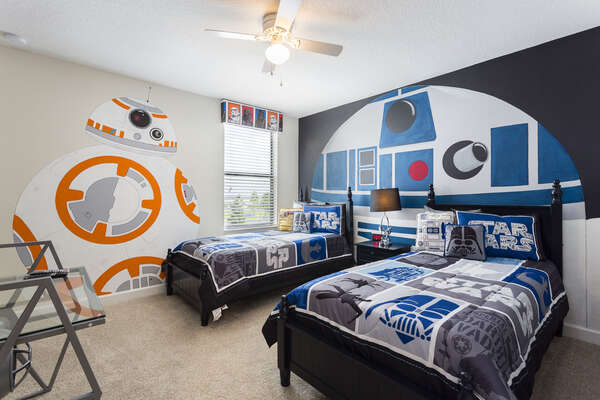 This galactic kids bedroom features 2 twin beds