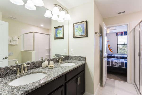 Jack and Jill style bathroom shared between bedrooms