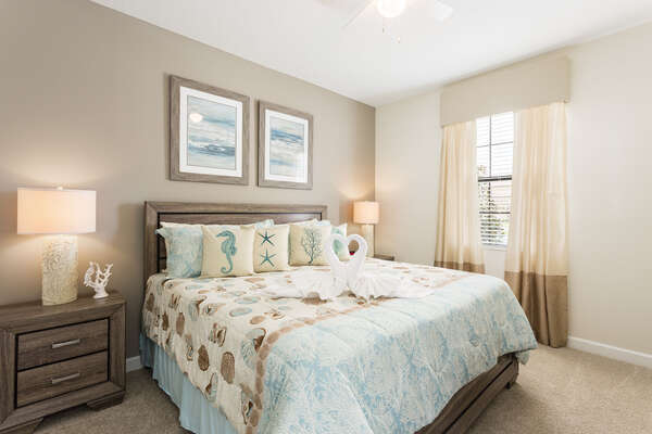 The neutral colors and beach theme are pure bliss in this bedroom with a King bed