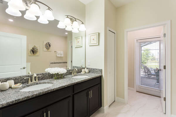 The ensuite master bathroom has easy access to the pool and plenty of space to get ready in the mornings