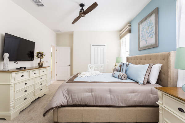 This first floor master suite is perfect for relaxing with a comfortable King bed and TV