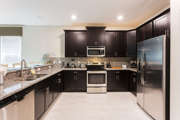 The kitchen has everything you need from high end stainless steel appliances, plenty of counter space and gorgeous granite counters