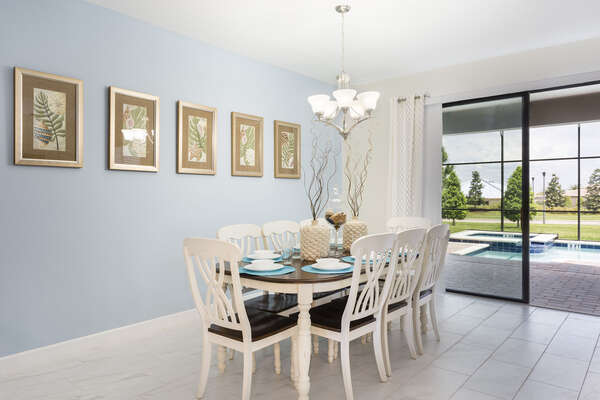 The formal dining space has seating for 8 to enjoy family meals together