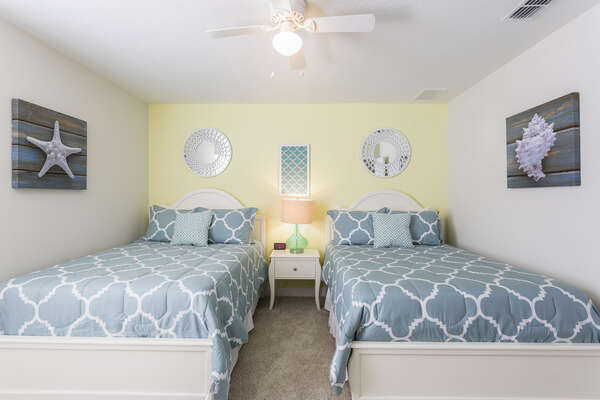 This beach themed bedroom features two full beds, perfect for teens