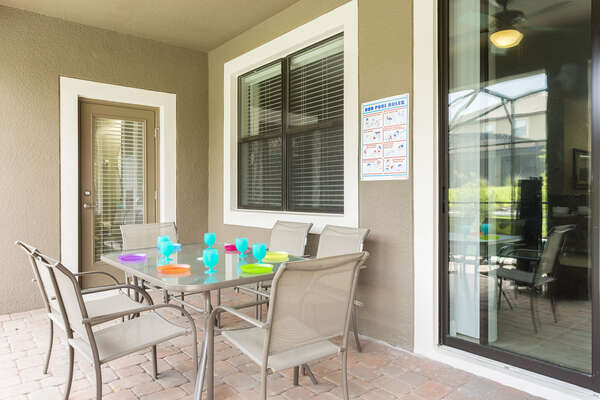 Dine al fresco at the outdoor dining table with seating for 6, and a second table with seating for another 6.