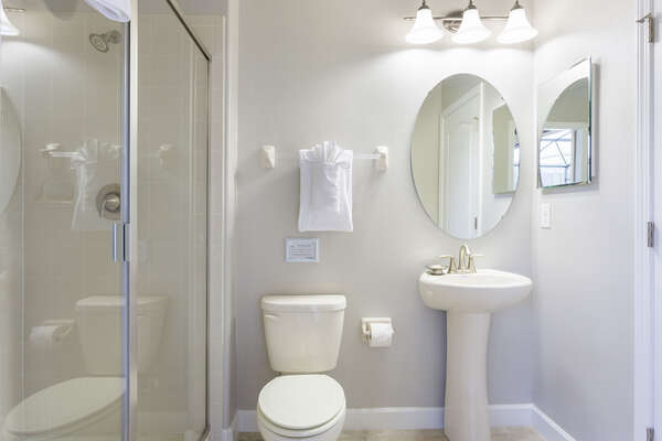 This bathroom features easy access to the pool area