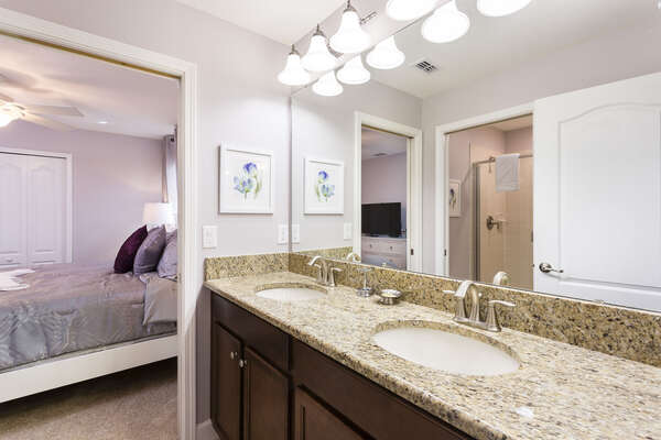 The Jack and Jill bathroom is shared between two bedrooms