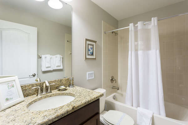 This bathroom features a combination shower and bathtub