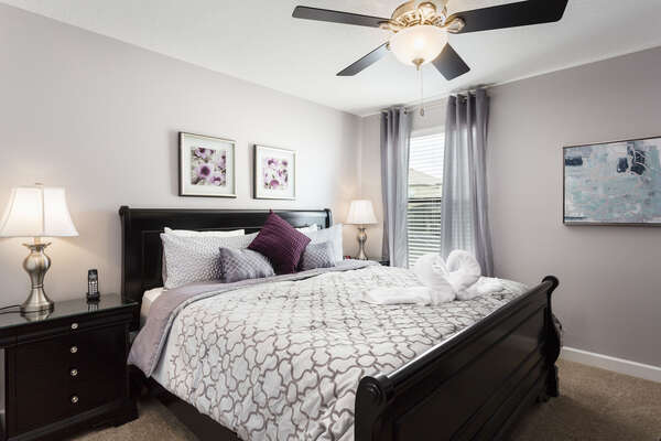 This king bedroom is located on the second floor and features an ensuite bathroom