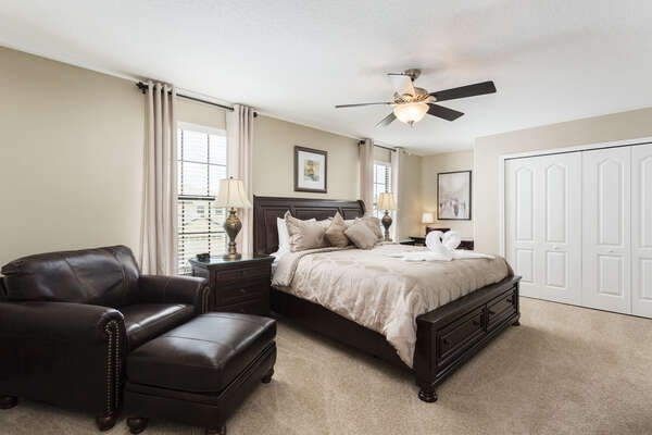This second floor master bedroom is very spacious and boasts a king bed and plush armchair