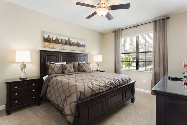 This master bedroom is located on the ground floor and features a comfortable King bed