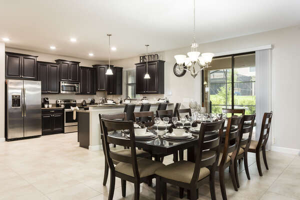 The open kitchen and dining area is great for spending time together on vacation
