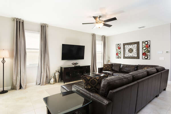 The whole family can gather together on this plush sectional and watch a favorite movie on the flatscreen TV