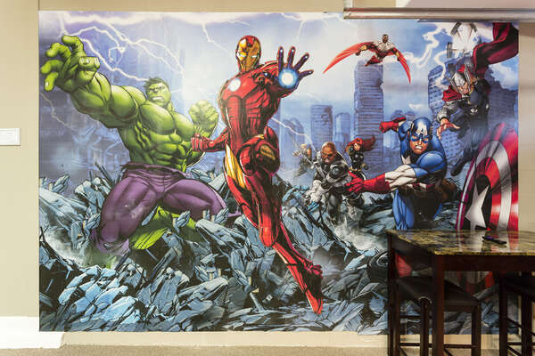 The wall mural features all your favorite superheroes