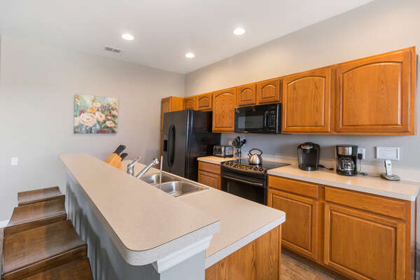 A fully equipped kitchen to prepare meals for all with breakfast seating for 4