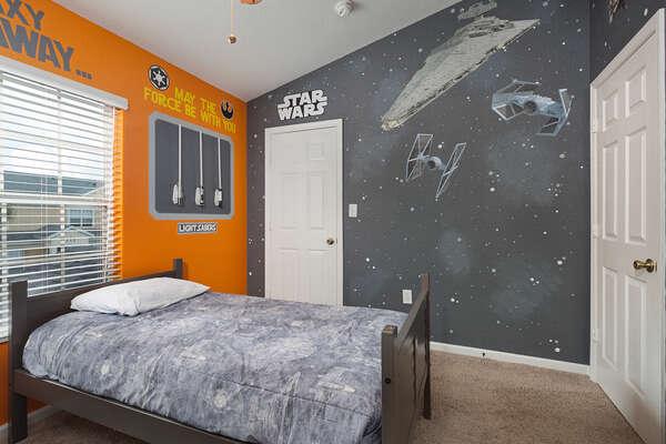 Custom art completes this fun kids bedroom