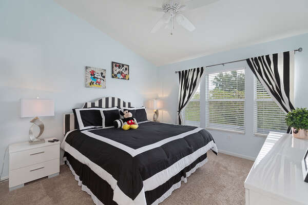 The second floor master suite with a King bed, TV, and en-suite bathroom