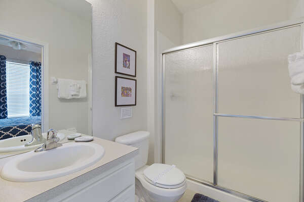 The ensuite bathroom also features access from the living area