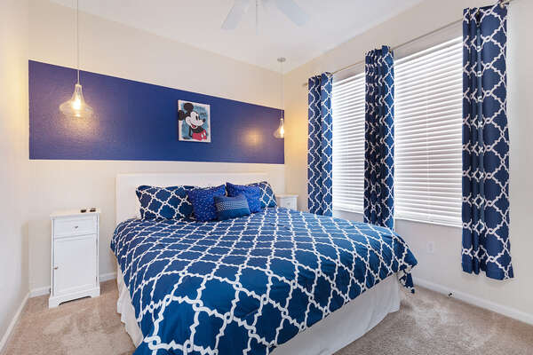 The Master Suite on the ground floor has a King bed and en-suite bathroom access