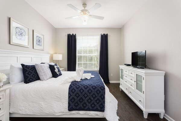 Relax in your private master suite featuring a king-sized bed