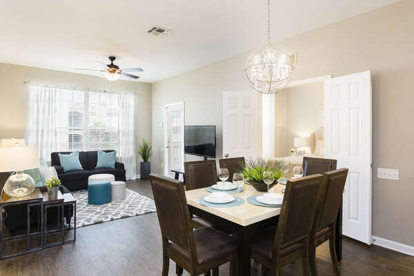 This open concept living and dining area is perfect for spending time together on your family vacation