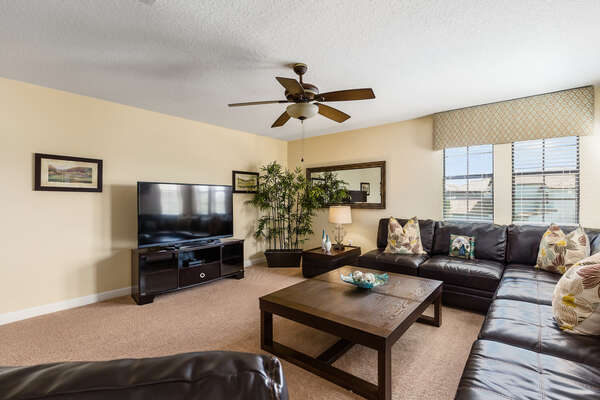 Luxurious upstairs den witha 60-Inch HD TV and a Sony PS3