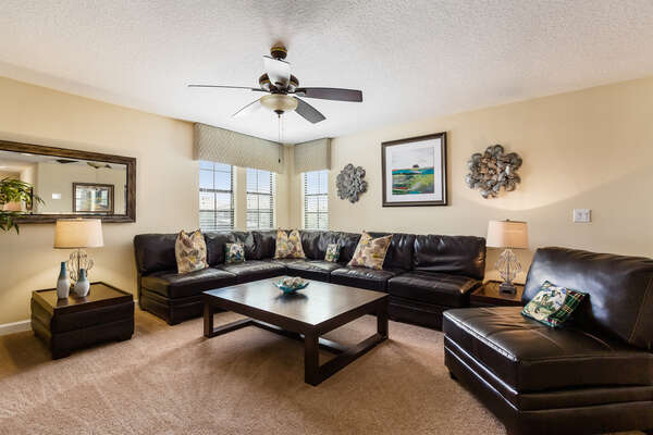 A luxurious upstairs loft is perfect for spending time together with a 60-Inch HD TV and a Sony PS3