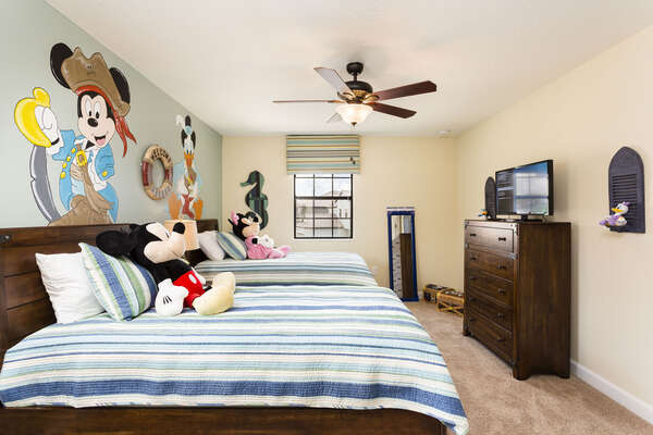 Kids will love their own custom bedroom, complete with their favorite characters, two comfortable beds and a TV