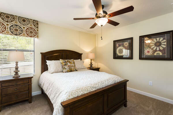 The fifth bedroom is located upstairs with a queen bed