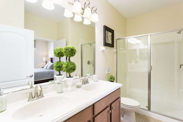 The bedroom features an ensuite bathroom