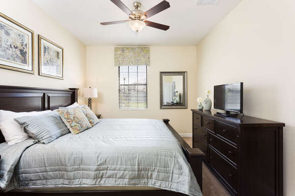 Located upstairs, the third master suite has a King bed and TV, perfect for relaxing after a long day at the parks