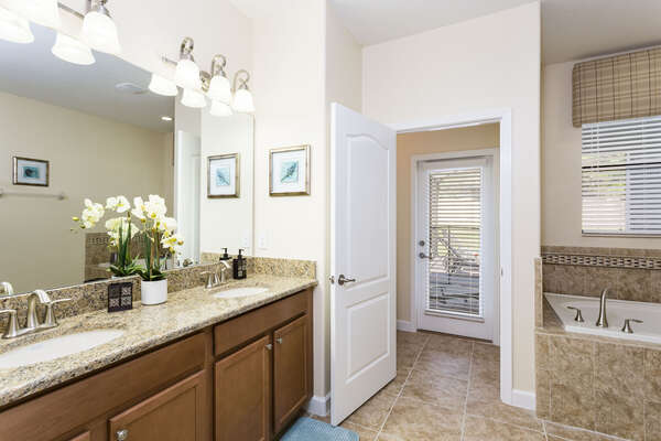 Ensuite master bathroom has access to the pool deck