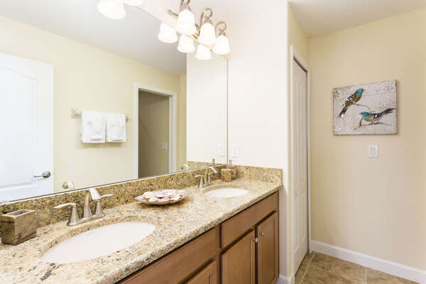 The ensuite bathroom has plenty of space to get ready
