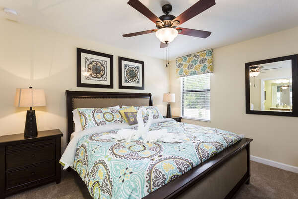 The fourth bedroom is complete with a king bed and fun designs