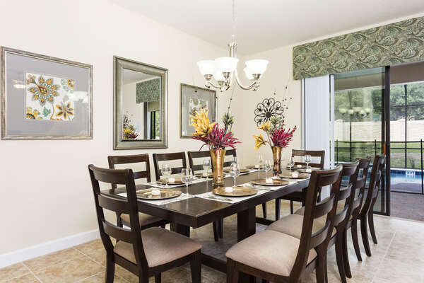 Dine all together at the formal dining table with seating for 10