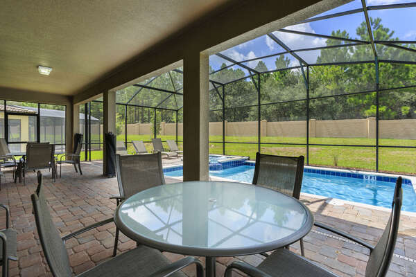Enjoy meals underneath the covered lanai and experience the beautiful Florida weather