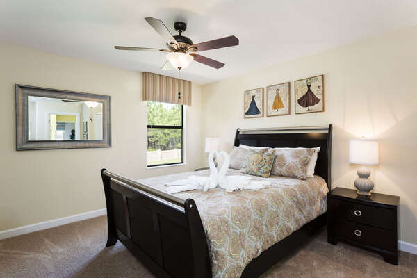 The final upstairs bedroom is perfect for relaxation with a comfortable queen bed
