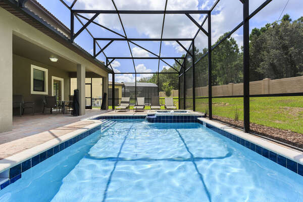 The whole family will love the private screened-in pool and spillover spa