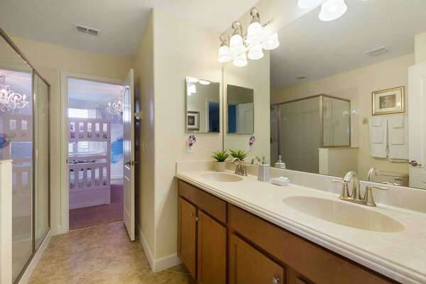 Jack and Jill style bathroom connects the kids ice princess bedroom