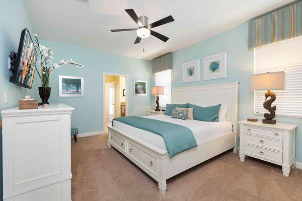 Getaway in this beach themed second master bedroom with a King size bed and TV