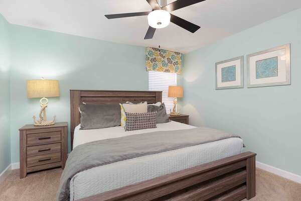 Unwind in your spacious beach themed bedroom with a King size bed