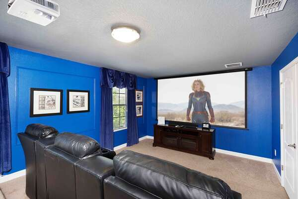 Located on the second floor, the home theater features 7 plush recliners for watching movies