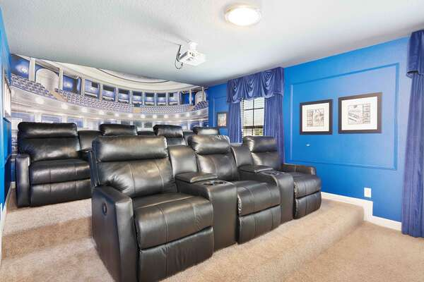 Pop some popcorn and watch a fun movie on the projector screen in the home theater room