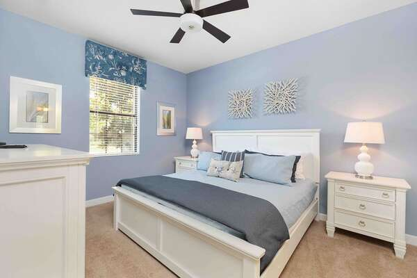This nautical master suite is located on the first floor and features a king bed and ensuite bathroom