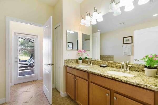 The ensuite master bathroom features a garden tub and walk-in shower