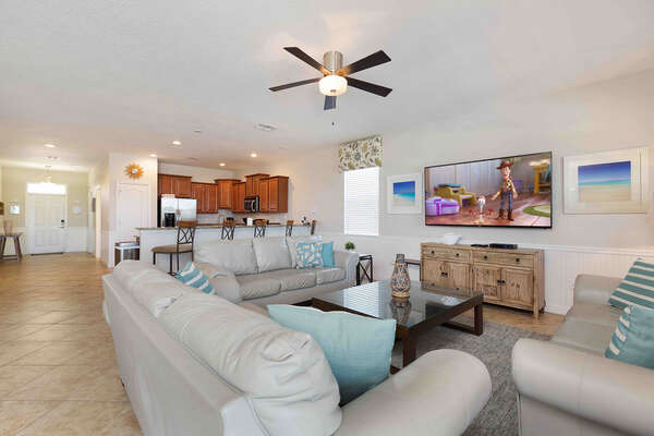 Relax on plush seating and watch a favorite show on the TV