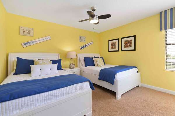 This second floor bedroom with two full sized beds is perfect for teenagers