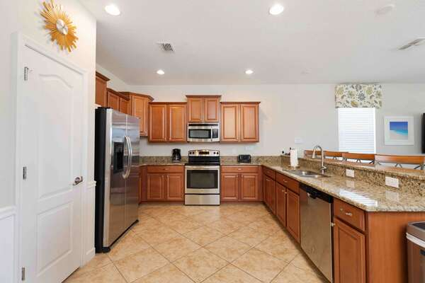 Fully equipped kitchen featuring stainless steel appliances and granite counters is great for making family meals