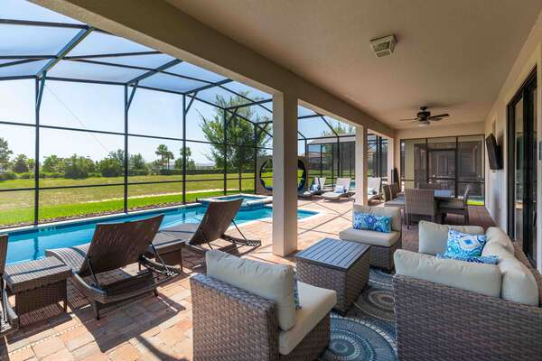 Spend the day lounging by the outside day bed seating area and watch all your favorite shows on the 55-inch TV